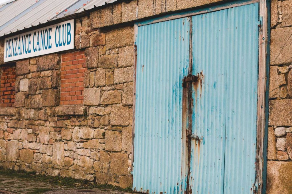 Penzance Canoe Club bricked front with turquoise door.