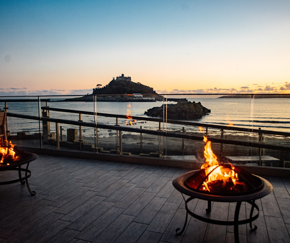 The outside seating area at The Godolphin, overlooking St Michael's Mount.