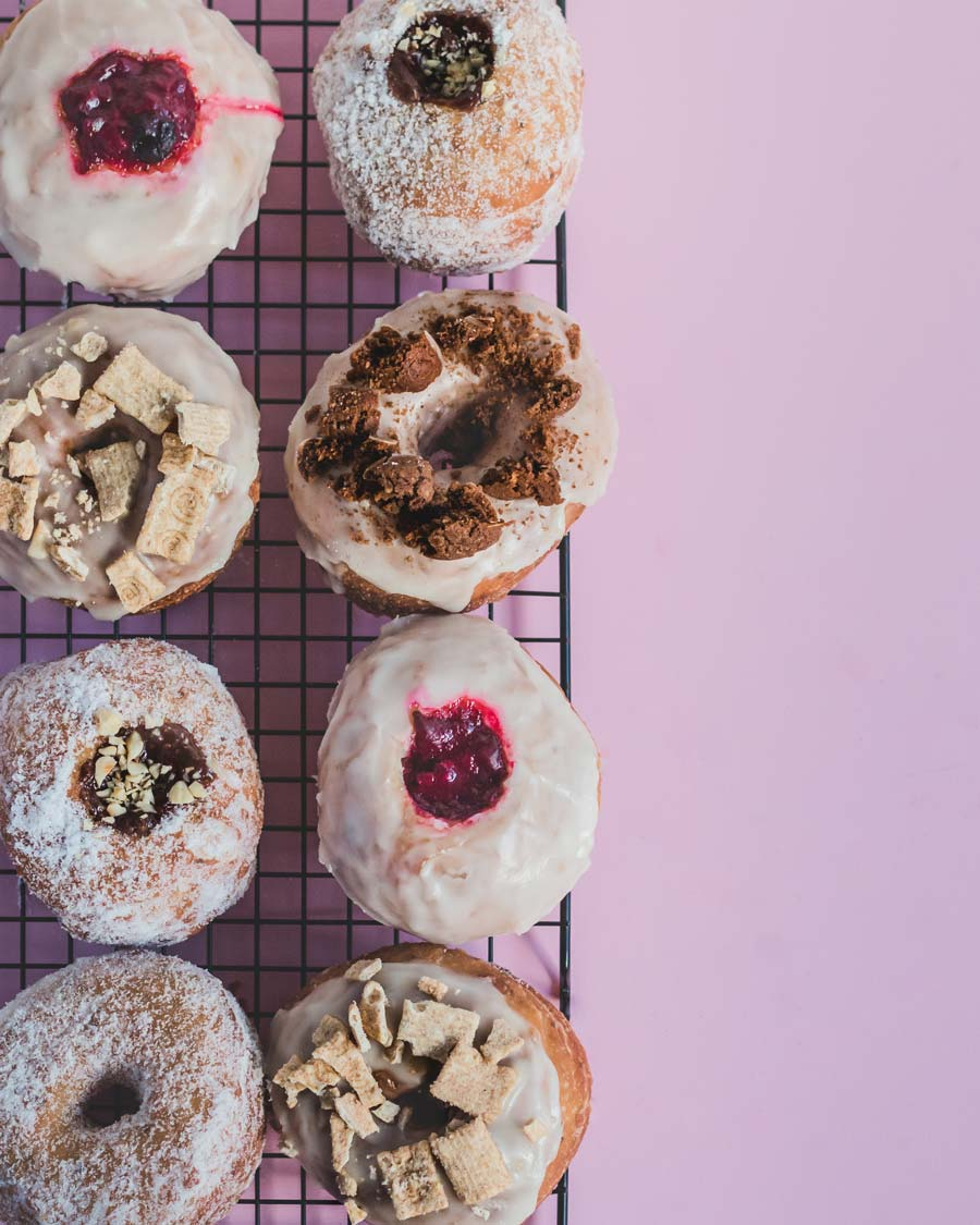 Overhead photo of an assortment of donut flavours from Beige Donuts